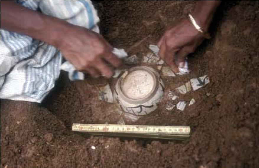The excavation of a complete Chinese porcelain bowl, R.M. Jayasena,2000 Katuwana Fort excavatio